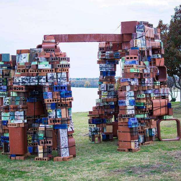 """Brickolage at TCC Northwest Campus,"" a new sculpture by NW art associate professor Fred Spaulding, frames the lake as it sits on the south end of the Fine Arts Building. Photo by Jason Floyd/The Collegian"